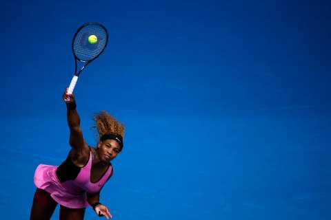 Serena Williams of the U.S. serves to Ana Ivanovic of Serbia during their women's singles match at the Australian Open 2014 tennis tournament in Melbourne