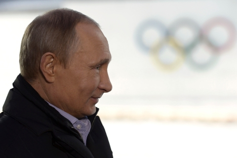 Russian President Putin listens to a journalist's question during a televised news conference in Sochi