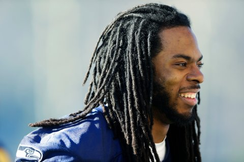 Seattle Seahawks cornerback Richard Sherman walks off the field after NFL football practice, Jan. 24, 2014, in Renton, Wash.