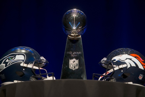 The Vince Lombardi trophy and Seattle Seahawks and Denver Broncos helmets at a press conference in advance of the Super Bowl in New York City, Jan. 31, 2014.