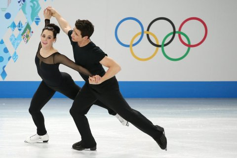 Tessa Virtue and Scott Moir of Canada perform during an ice dance figure skating training session at Iceberg Skating Palace during the Sochi 2014 Olympic Games, February 5, 2014.