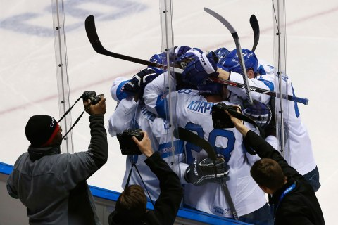 Photographers capture the celebration of Finland's Selanne and his linemates after he scored against Team USA during the second period of their men's ice hockey bronze medal game at the Sochi 2014 Winter Olympic Games