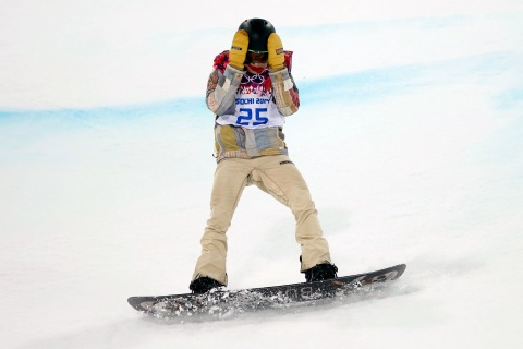 Shaun White of the U.S. reacts after crashing during the men's snowboard halfpipe final event at the 2014 Sochi Winter Olympic Games in Rosa Khutor