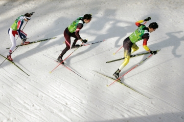 Haavard Klemetsen of Norway, Christoph Bieler of Austria and Bjoern Kircheisen of Germany compete in the Nordic Combined Men's Team 4 x 5 km.