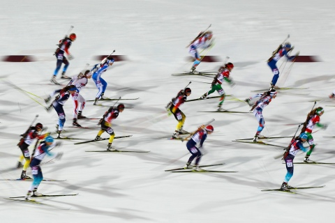 Skiers compete during the women's biathlon 12.5km mass start event at the Sochi 2014 Winter Olympic Games in Rosa Khutor