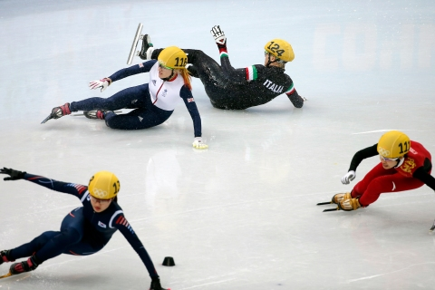 Elise Christie (rear left) of Great Britain and Arianna Fontana (rear right) of Italy collide in the women's 500m final of the Short Track events.