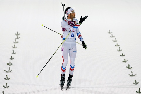 France's Martin Fourcade blows a kiss just before he crosses the line to win the men's biathlon 12.5k pursuit.