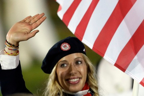 United States's Mariel Zagunis carries the flag during the Opening Ceremony at the 2012 Summer Olympics, Friday, July 27, 2012, in London.