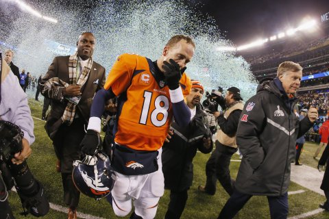 Quarterback Peyton Manning of the Denver Broncos reacts as he walks off the field after their 43-8 loss to the Seattle Seahawks during Super Bowl XLVIII.