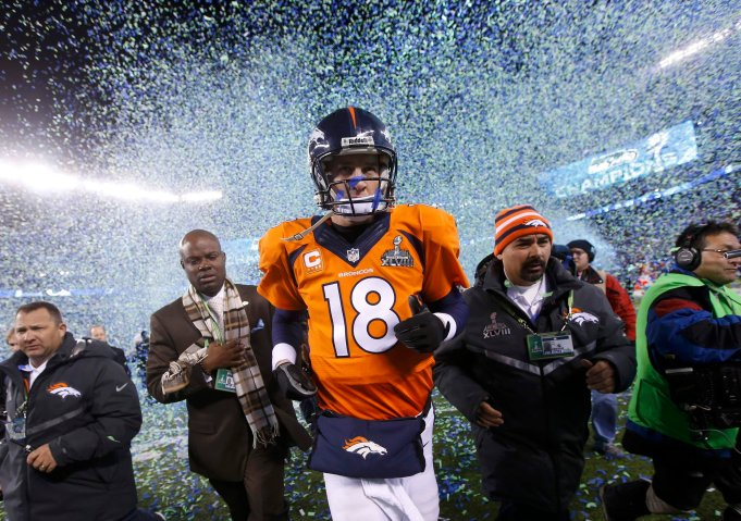 Denver Broncos quarterback Peyton Manning runs off the field after being defeated by the Seattle Seahawks in the NFL Super Bowl XLVIII football game in East Rutherford