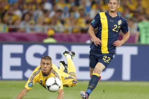 Sweden's Rosenberg challenges Ukraine's Khacheridi during their Group D Euro 2012 soccer match at Olympic Stadium in Kyiv